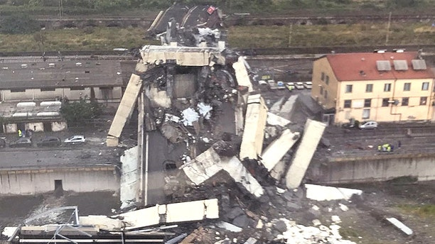 Vehicles were crushed under the rubble after the bridge in Genoa collapsed.