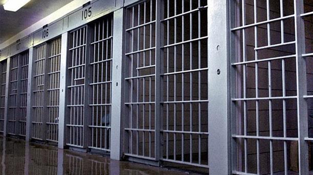 Prison bars are shown.