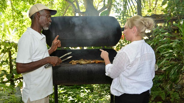 Learning some of the fundamentals of making Jamaican Jerk Chicken through the Meet the People program, which pairs volunteers with visitors.