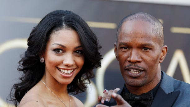 """Actor Jamie Foxx, of best picture nominated film """"Django Unchained"""", poses with his daughter Corinne Bishop at the 85th Academy Awards in Hollywood, California February 24, 2013. REUTERS/Lucas Jackson (UNITED STATES  - Tags: ENTERTAINMENT)  (OSCARS-ARRIVALS) - RTR3E9FW"""