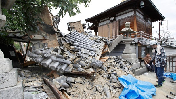 The gate of Myotoku-ji temple is shown after it collapsed following an earthquake in Ibaraki City, Osaka, western Japan, June 18, 2018.