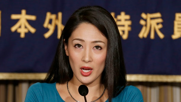 Miss International 2012 Ikumi Yoshimatsu speaks during a press conference at the Foreign Correspondents' Club of Japan in Tokyo Monday, Dec. 16, 2013.  Yoshimatsu, a Japanese beauty queen won't be handing over her crown to her successor after she refused to sign with a major talent agency.