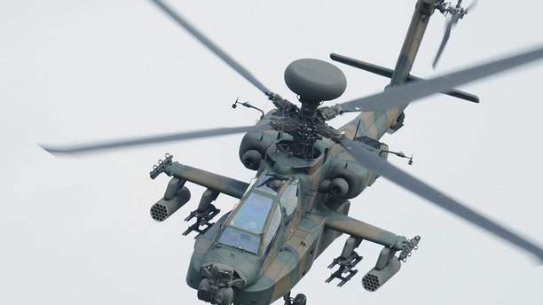 A photo provided by Japan's Ground Self-Defense Force shows an AH-64D helicopter, the same model as the one that crashed in Japan.