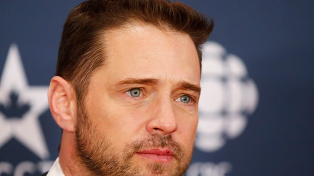 Actor Jason Priestly arrives on the red carpet at the 2014 Canadian Screen awards in Toronto, March 9, 2014.   REUTERS/Mark Blinch (CANADA  - Tags: ENTERTAINMENT)   - RTR3GCWY