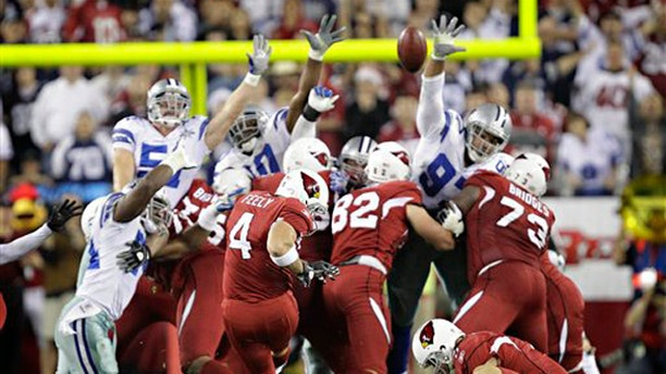 Arizona Cardinals place kicker Jay Feely (4) kicks the game winning field goal during the fourth quarter of an NFL football game Saturday, Dec. 25, 2010, in Glendale, Ariz. The Cardinals won 27-26.(AP Photo/Matt York)