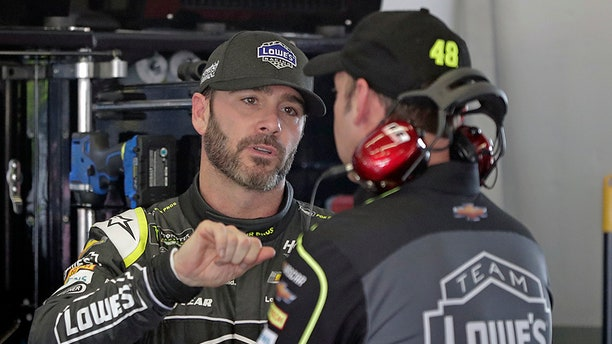 Jimmie Johnson talks with crew chief Chad Knaus during practice for the Daytona 500.
