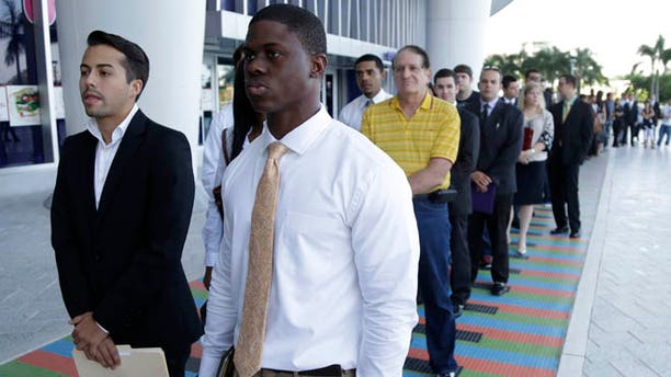 Oct. 23, 2013: College students wait in line at a job fair held by the Miami Marlins, at Marlins Park in Miami.