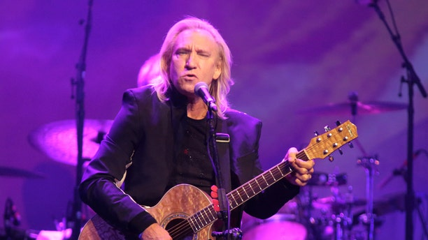 FILE - In this Oct. 12, 2015 file photo, Joe Walsh of the band The Eagles performs in a solo concert at The Fillmore in Philadelphia. Eagles keyboardist and guitarist Walsh says hes pulling out of a Cleveland summer concert he thought would be a nonpartisan event for veterans families because its actually a launch for the Republican National Convention. The concert is scheduled for July 18, 2016. (Photo by Owen Sweeney/Invision/AP, File)