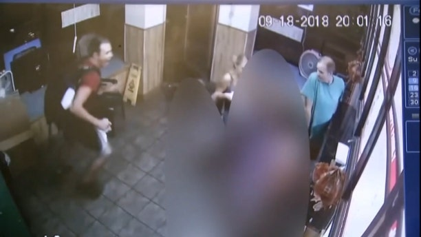 Surveillance video from the takeout restaurant showed shocked patrons attempting to save Martinez's life.