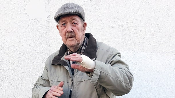 John Nixon, an 88-year-old British military veteran, rescued a young woman from two knife-wielding robbers.