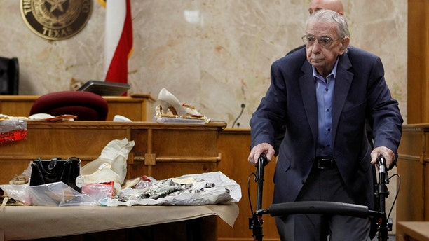 Former priest John Feit walks past clothing worn by Irene Garza during the fourth day of his trial for the 1960 murder of Garza at the Hidalgo County Courthouse in Edinburg, Texas, December 5, 2017.