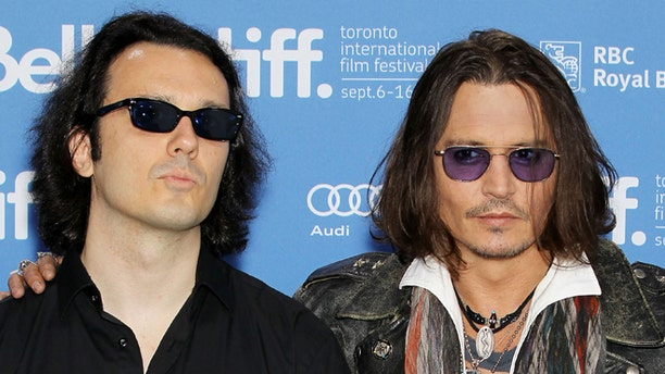 """Sept. 8, 2012: This image released by Starpix shows Damien Echols, one of the West Memphis Three, left, and actor Johnny Depp at a press conference for the film """"West of Memphis"""" at the 2012 Toronto International Film Festival in Toronto."""