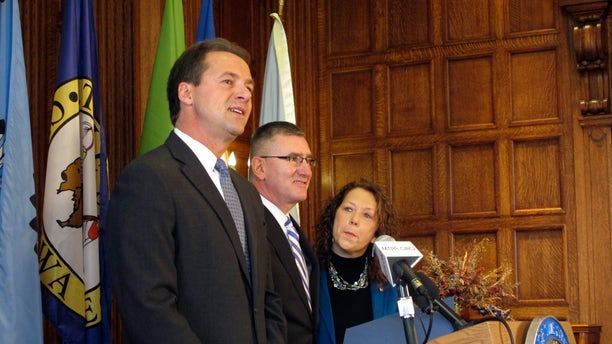 Feb. 7, 2014: Montana Gov. Steve Bullock, left, introduces his lieutenant governor, John Walsh, as his interim appointment to the U.S. Senate in Helena, Mont.