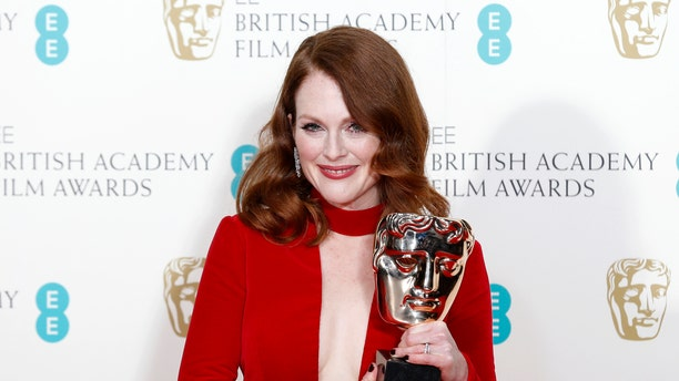 """February 8, 2015. Actress Julianne Moore poses after receiving the award for best leading actress for """"Still Alice"""" at the British Academy of Film and Arts (BAFTA) awards ceremony at the Royal Opera House in London."""