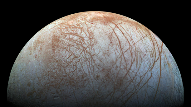 The frozen surface of Jupiter's icy moon Europa is seen in extreme detail in this remastered photo made from images taken by NASA's Galileo spacecraft in the late 1990s. A new study suggests that the ice on Europa may move between the moon's poles and its equator.