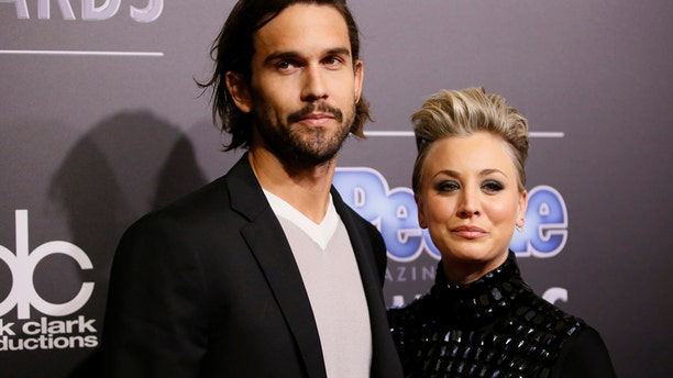 Actress Kaley Cuoco-Sweeting and husband Ryan Sweeting arrive at the People Magazine Awards in Beverly Hills, California December 18, 2014.
