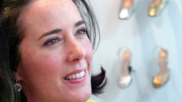 In this May 13, 2004 file photo, designer Kate Spade poses with shoes from her next collection in New York.
