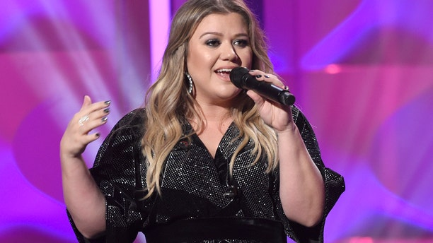 Kelly Clarkson accepts the powerhouse award at the Billboard Women in Music event at the Ray Dolby Ballroom on Thursday, Nov. 30, 2017, in Los Angeles.