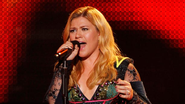 December 16, 2012. Kelly Clarkson performs during the VH1 Divas show in Los Angeles.