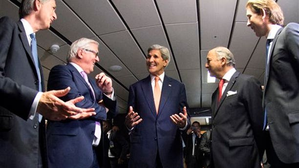French Foreign Minister Laurent Fabius, second right, German Foreign Minister Frank-Walter Steinmeier, second left, British Foreign Secretary Philip Hammond, left, US Secretary of State John Kerry, center, and Austria's Foreign Minister Sebastian Kurz, right, talk prior to their final plenary meeting at the United Nations building in Vienna, Austria July 14, 2015. After 18 days of intense and often fractious negotiation, diplomats Tuesday declared that world powers and Iran had struck a landmark deal to curb Iran's nuclear program in exchange for billions of dollars in relief from international sanctions, an agreement designed to avert the threat of a nuclear-armed Iran and another U.S. military intervention in the Muslim world. (Joe Klamar/Pool Photo via AP)