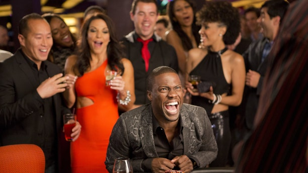 "Kevin Hart, center, as Cedric in a scene from ""Think Like A Man Too."""