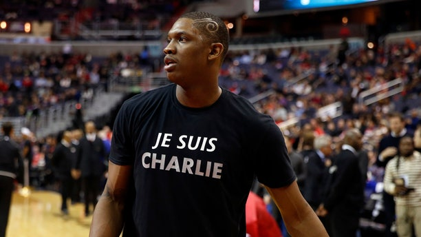 "Jan. 9, 2015: Washington Wizards center Kevin Seraphin, from France, wears a ""Je Suis Charlie"" T-shirt during warmups for an NBA basketball game against the Chicago Bulls."