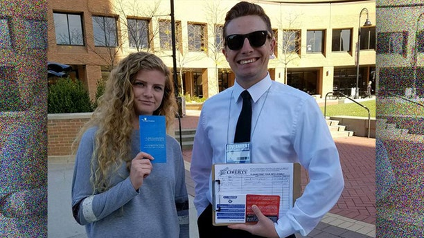 "Students Kaitlin Bennett (L) and Kevin Cline (R) participate in a ""Restore the Fourth Amendment"" event at Kent State University."