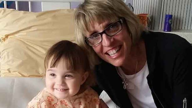 Cindy Smith, right, donated a kidney to her granddaughter Clara, left.