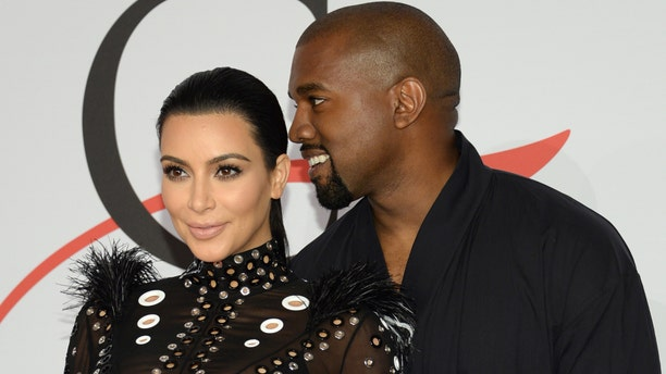 June 1, 2015. Kim Kardashian, left, and Kanye West arrive at the 2015 CFDA Fashion Awards at Alice Tully Hall, Lincoln Center, in New York.