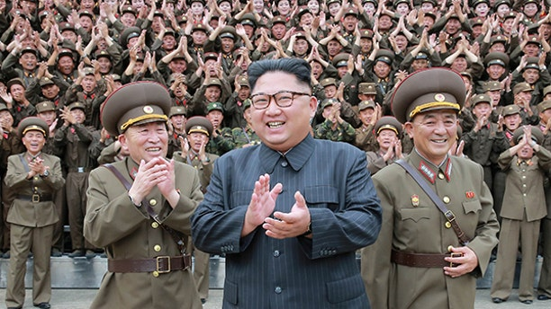 North Korean leader Kim Jong Un claps with military officers at the Command of the Strategic Force of the Korean People's Army (KPA) in an unknown location in North Korea in this undated photo released by North Korea's Korean Central News Agency (KCNA) on August 15, 2017.   KCNA/via REUTERS   ATTENTION EDITORS - THIS PICTURE WAS PROVIDED BY A THIRD PARTY. NO THIRD PARTY SALES.  SOUTH KOREA OUT. NO COMMERCIAL OR EDITORIAL SALES IN SOUTH KOREA.  TPX IMAGES OF THE DAY - RTS1BTNU