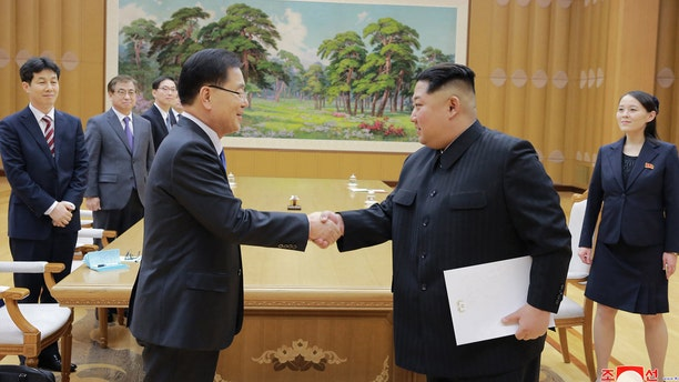 North Korean leader Kim Jong Un, front right, shakes hands with South Korean National Security Director Chung Eui-yong after Chung gave Kim a letter from South Korean President Moon Jae-in, in Pyongyang, North Korea.