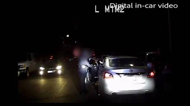 Authorities in California released dramatic footage that shows an LAPD officer being shot at point-blank range during a traffic stop.