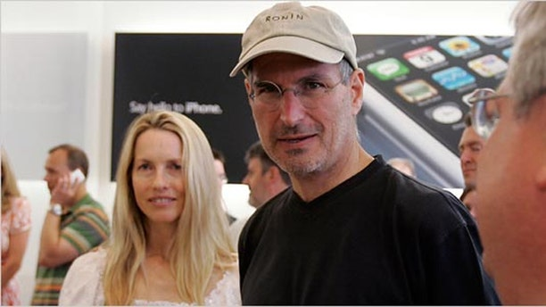 Steve Jobs with wife Laurene Powell Jobs, in 2007.
