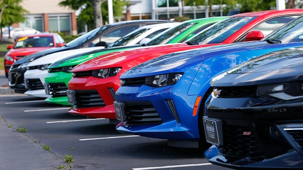 In this Wednesday, April 26, 2017, photo, Chevrolet Camaros are lined up in the lot of a Chevrolet dealership in Richmond, Va. As the end of your car lease approaches, you may start to see every scratch, stain and extra mile as another dollar coming out of your pocket. But by learning how the lease-ending process works, and what damage you're likely to be charged for, you can avoid excess wear and tear on your wallet. (AP Photo/Steve Helber)