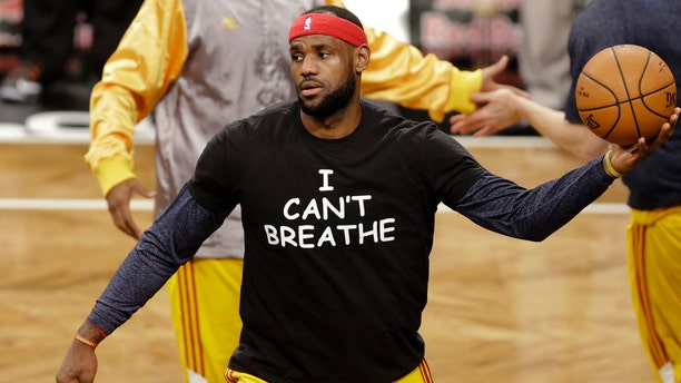 """Cleveland Cavaliers' LeBron James wears a T-shirt reading """"I Can't Breathe,"""" protesting the death of Eric Garner while being arrested by NYPD officers, warms up before an NBA basketball game against the Brooklyn Nets in New York."""