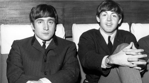 1st November 1963:  Two members of Liverpudlian pop group The Beatles, John Lennon (1940 - 1980), singer and guitarist, left, and Paul McCartney, singer and bass guitarist.  (Photo by Fox Photos/Getty Images)