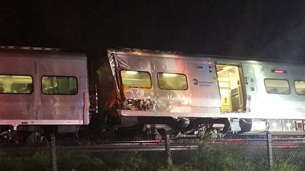 Oct. 8, 2016: A Long Island Railroad commuter train sits on the tracks after derailing in Nassau County, N.Y.