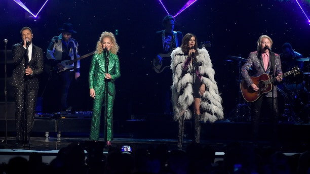 """Little Big Town sang Elton John's """"Rocket Man"""" at the ACMs in celebration of the icon's new album, """"Restoration,"""" which features country singers covering his songs."""