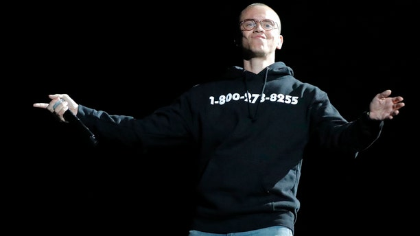 Rapper Logic preforms at the 60th Annual Grammy Awards.