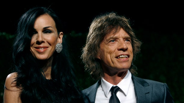 Feburary 22, 2009. Designer L'Wren Scott and rock musician Mick Jagger pose as they arrive at the 2009 Vanity Fair Oscar Party in West Hollywood, California.