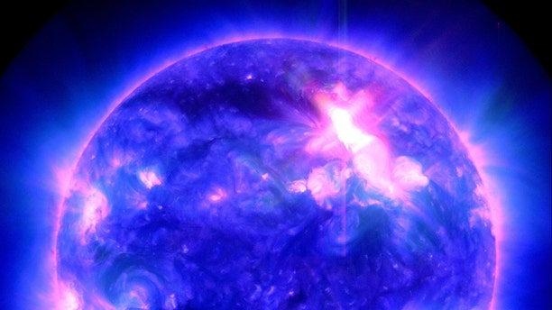 A powerful M9-class solar storm that unleashed a coronal mass ejection toward Earth in the early hours of Jan. 23, 2012 (GMT).