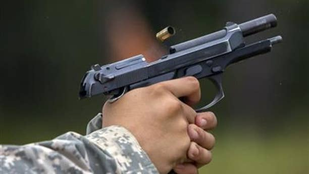 A 9mm case is ejected from the chamber of a Beretta M9 during a qualifying exercise for the 139th Military Police Company, Tuesday, Sept. 29, 2015, in Fort Stewart, Ga. The Army wants to replace its M9, a 9mm semi-automatic handgun adopted during the Cold War.