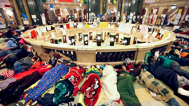 Opponents of Wisconsin Gov. Scott Walker's budget bill sleep in the rotunda of the Wisconsin State Capitol Feb. 22.