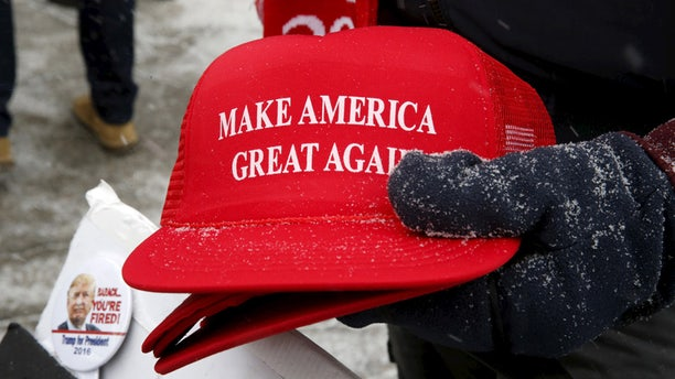"""A vendor is seen selling """"Make America Great Again"""" hats in New Hampshire."""