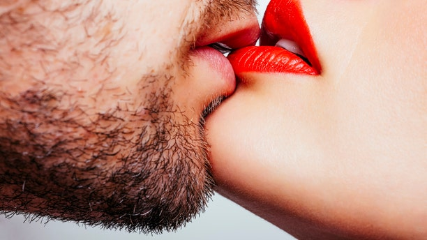 Close up of a men and woman lips wants to kiss.