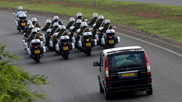 Dec. 14, 2013: Motorcycles escort a hearse carrying the casket of former South African President Nelson Mandela en route to Waterkloof Air Base on the outskirts of Pretoria, South Africa.