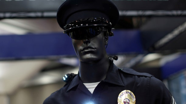 FILE PHOTO: A mannequin dressed as a police officer to show off a body camera system is shown on display at the International Association of Chiefs of Police conference in San Diego, California, U.S. on October 17, 2016. (REUTERS/Mike Blake)