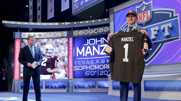 May 8, 2014. Texas A&M quarterback Johnny Manziel poses for photos after being selected by the Cleveland Browns as the 22nd pick in the first round of the 2014 NFL Draft in New York.