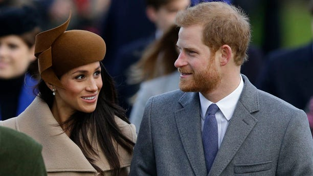 Meghan Markle and Prince Harry stopped to talk to people while walking to the queen's residence.