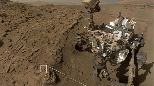 """This photo shows NASA's Mars rover Curiosity at a location called """"Windjana,"""" where the rover found rocks containing manganese-oxide minerals, which require abundant water and strongly oxidizing conditions"""